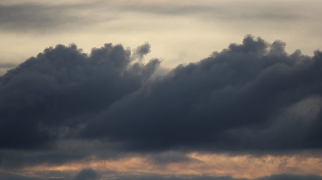 Photo of clouds at sunset, by Susie.