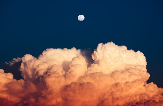 Photo of the moon over clouds, by Lyv Jaan